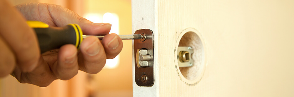 Handyman working on door